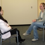 Hsin-hsin Huang, assistant professor of social work, and Kristina Schiber, social work graduate student, role play a typical simulated client lab scenario.