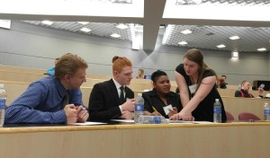 Members of the Collinsville High School team discuss their response during the final round of the 2016 High School Ethics Bowl at the Engineering Building Saturday. The event was hosted by the SIUE Lyceum philosophy club. (photo by Joseph Lacdan)