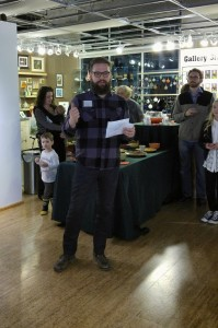 Matty Kleinberg, visiting scholar in printmaking, speaks at the premier of the SIUE history museum's annual exhibit at the Edwardsville Art Center Feb. 18. (Photo by Joseph Lacdan)