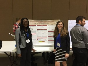 SIUE junior Kelly Buch (right) presented her research in a poster and oral presentation in January. (Courtesy photo)