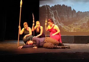"""(From left) Samantha Koester, Emily Moore, Amanda Furrow, and Tyler Ciesler (bottom) perform a pivotal scene in """"the Magic Flute."""" (Photo by Joseph Lacdan)"""