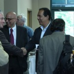 The University of Havana delegates shaking hands before their lecture on their visit to SIUE