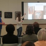 From left: Paul Chester, Melody Chester and Clinton Sipes (seated) presenting photos from their study on tattoos